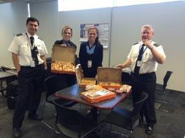 DEN crew members enjoying pizza!